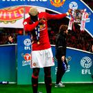 Manchester United's Paul Pogba dabs after the EFL Cup Final at Wembley Stadium