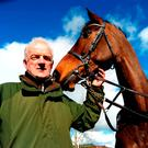 Willie Mullins with his Queen Mother Champion Chase ante-post favourite, Douvan, during a special open day at his yard in Closutton yesterday. Photo: PA Wire