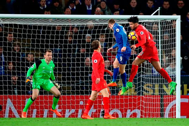 Jamie Vardy rises above the challenge of Liverpool defender Emre Can to score his second goal of the night. Photo by Julian Finney/Getty Images