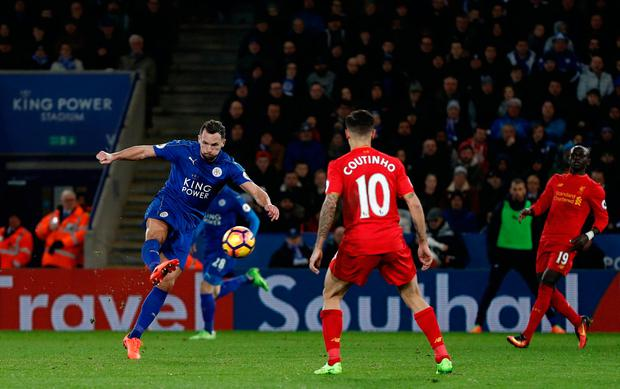 Leicester City's Danny Drinkwater (L) shoots to score their second goal