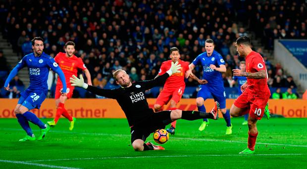Kasper Schmeichel of Leicester City makes a save from Philippe Coutinho