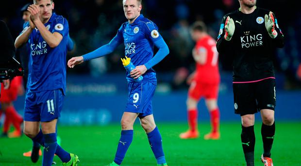 Leicester City's (left to right) Marc Albrighton, Jamie Vardy and Kasper Schmeichel