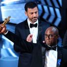 Barry Jenkins, writer and director of 'Moonlight', holds up the Best Picture Oscar as host Jimmy Kimmel looks on. Initially, the winner was mistakenly announced as 'La La Land'. Photo: Lucy Nicholson/Reuters