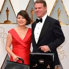Martha Ruiz and Brian Cullinan, the representatives of PricewaterhouseCoopers responsible for the safekeeping of the Oscar envelopes and their distribution at the ceremony, arrive before the show with their briefcases with the winners' names Picture: AP