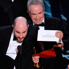 'La La Land' producer Jordan Horowitz shows the envelope revealing 'Moonlight' as the true winner of the best picture Oscar, while presenter Warren Beatty and host Jimmy Kimmel look on Picture: AP