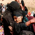 An elderly woman is comforted by a relative as displaced families flee their homes as Iraqi forces battle with Isil militants in western Mosul. Photo: Reuters/Zohra Bensemra