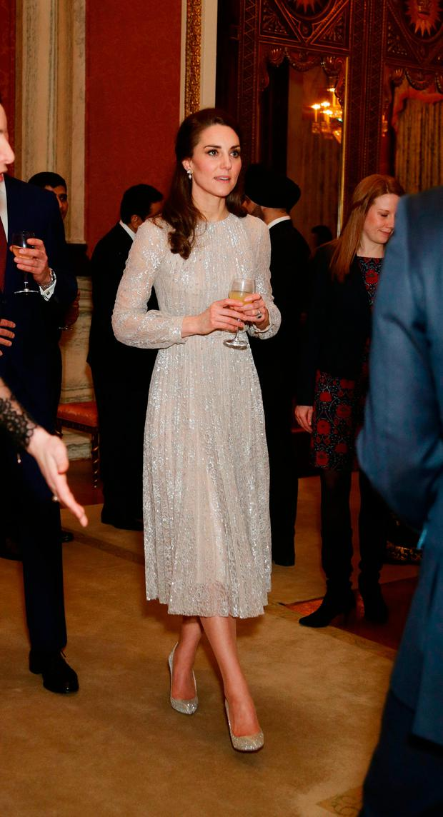 Britain's Catherine, Duchess of Cambridge, (L) attends a reception to mark the launch of the UK-India Year of Culture 2017 at Buckingham Palace in London on February 27, 2017. / AFP PHOTO / POOL / Yui MokYUI MOK/AFP/Getty Images