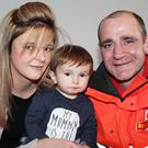 Hero postman Darren Dixon with little Caleb Campbell and his Mum Megan McCandless (Image Mark Jamieson via the Belfast Telegraph)