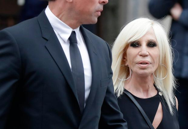 Fashion designer Donatella Versace leaves the Duomo gothic cathedral after attending a memorial mass for late Vogue Italia editor-in-chief Franca Sozzani, in Milan, Italy, Monday, Feb. 27, 2017. (AP Photo/Luca Bruno)