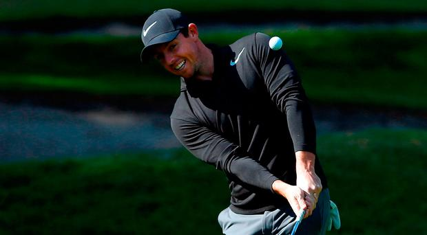 Rory McIlroy plays a chip during a practice round yesterday ahead of the Mexico Championship. Photo: Jamie Squire/Getty Images