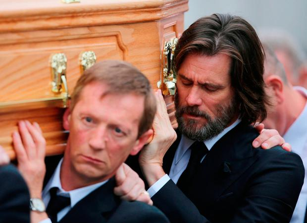Jim Carrey carrying her coffin at the funeral Photo: Niall Carson/PA Wire