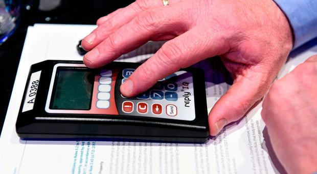 A delegate prepares to vote 'Yes' during last weekend's GAA annual Congress in Dublin. Photo by Ray McManus/Sportsfile