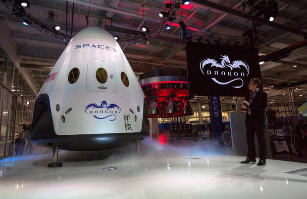 SpaceX CEO Elon Musk with the Dragon V2 spacecraft Photo: Reuters/Mario Anzuoni