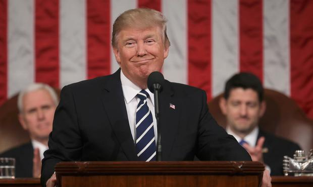 President Donald Trump delivers his first address to a joint session of Congress Photo: Reuters/Jim Lo Scalzo/Pool