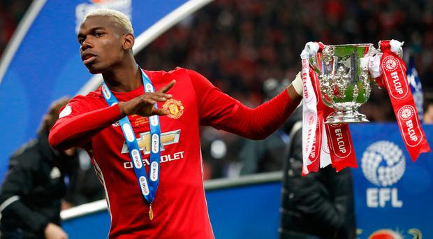 Manchester United's Paul Pogba celebrates with the EFL trophy