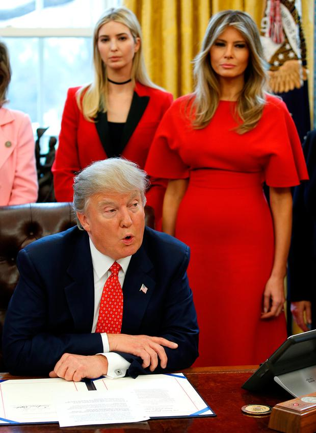 U.S. President Donald Trump speaks before signing H.R. 321 as U.S. first lady Melania Trump (R) and Ivanka Trump listen in the Oval Office of the White House, in Washington, DC, U.S. February 28, 2017. REUTERS/Joshua Roberts