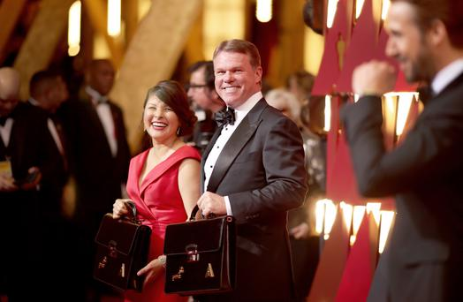 (L-R) Representatives from PricewaterhouseCoopers, Martha L. Ruiz, Brian Cullinan and actor Ryan Gosling at the Oscars. (Photo by Christopher Polk/Getty Images)