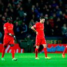 Liverpool players look dejected during the Premier League match against Leicester City