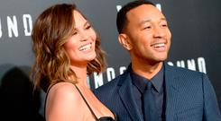 Model Chrissy Teigen (L) and actor/singer/executive producer John Legend attend WGN America's