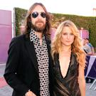 Musician Chris Robinson and Kate Hudson arrive at the premiere of