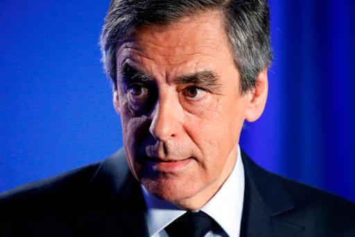 Francois Fillon, former French prime minister, member of the Republicans political party and 2017 presidential election candidate of the French centre-right, reacts as he makes a declaration to the media at his campaign headquarters in Paris, France, March 1, 2017. REUTERS/Charles Platiau