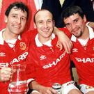 MANCHESTER, ENGLAND - MAY 8: Bryan Robson, Mike Phelan and Roy Keane of Manchester United celebrates in the dressing room with the Premiership Trophy after becoming FA Carling Premiership Winners in the 1993-94 season at Old Trafford on May 8, 1994. Manchester United 0 Coventry City 0 (Photo by John Peters/Manchester United via Getty Images)