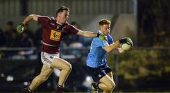 1 March 2017; Aaron Byrne of Dublin in action against Liam O'Reilly of Westmeath during the EirGrid Leinster GAA Football Under 21 Championship Quarter-Final match between Westmeath and Dublin at Lakepoint in Mullingar, Co Westmeath. Photo by Piaras Ó Mídheach/Sportsfile
