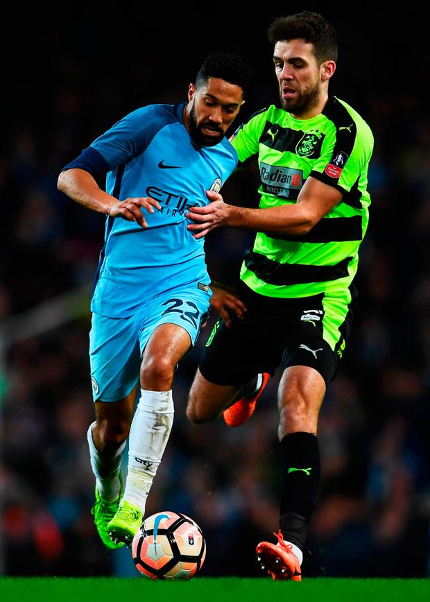 Gael Clichy of Manchester City battles with Tommy Smith of Huddersfield Town (Photo by Laurence Griffiths/Getty Images)