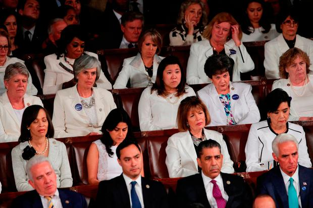 Members of Congress wear white to honour the women's suffrage movement and support women's rights during President Trump's address. Photo: Getty Images