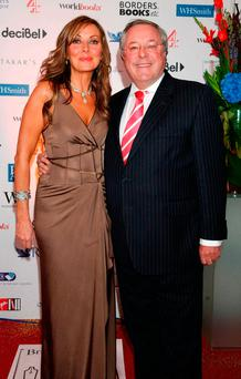 Former 'Countdown' host Richard Whiteley with his co-presenter Carol Vorderman in 2005. Photo credit should rea: Yui Mok/PA