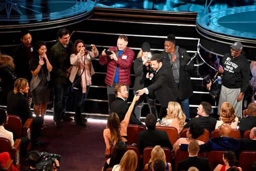 Host Jimmy Kimmel (C) surprises tourists during the 89th Annual Academy Awards at Hollywood & Highland Center. Photo: Kevin Winter/Getty Images