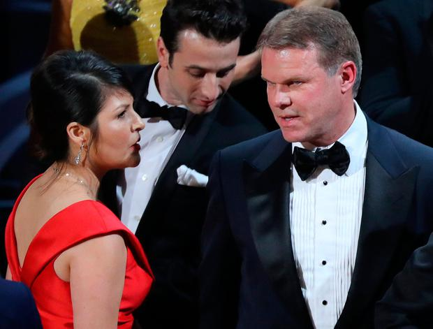Martha Ruiz (L) and Brian Cullinan (R) of PricewaterhouseCoopers confer on stage after the Best Picture was mistakenly awarded to 'La La Land' instead of 'Moonlight'. Photo: REUTERS/Lucy Nicholson