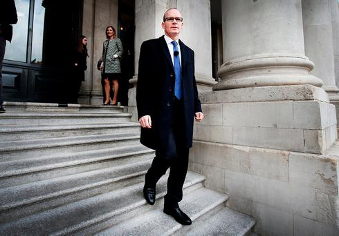 Simon Coveney leaving City Hall in Dublin yesterday after announcing details of the housing assistant payment scheme. Photo: Steve Humphreys