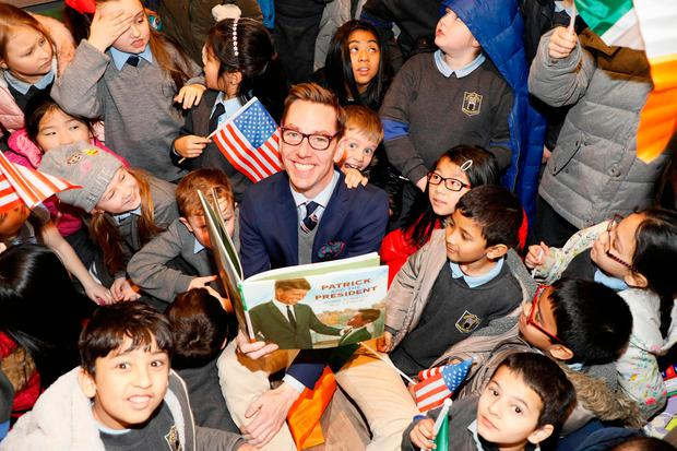 Broadcaster Ryan Tubridy pictured at the launch of his new book with Irish Children's Laureate P.J Lynch, 'Patrick and the President', in Eason O'Connell Street, also pictured are pupils of the Central Model Senior School on Marlborough Street. Photo Kieran Harnett