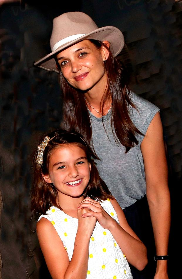 Suri Cruise and mother Katie Holmes pose backstage at the hit musical