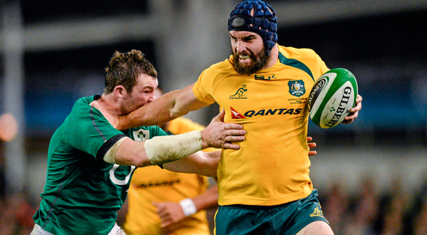 Scott Fardy, Australia, is tackled by Peter O'Mahony, Ireland in 2013