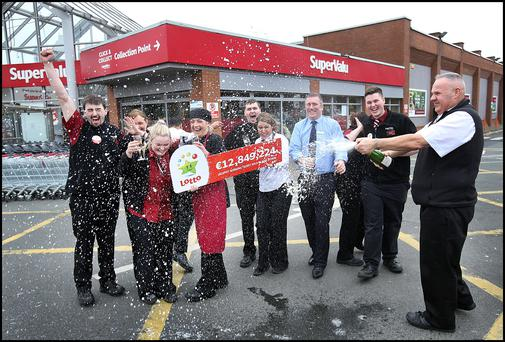 The staff at SuperValu in Knocklyon Shopping Centre celebrate as they sold the winning lottery ticket on Wednesday night for €12,849,224. Photo Steve Humphreys
