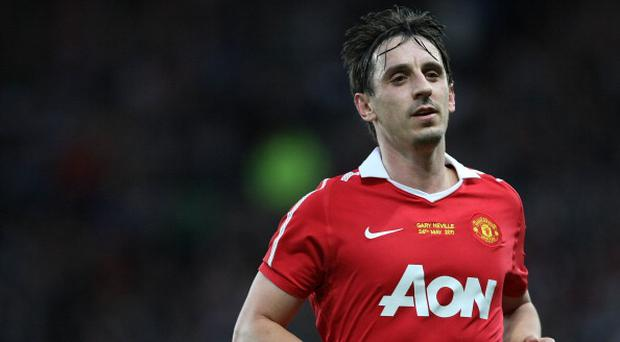 MANCHESTER, ENGLAND - MAY 24: Gary Neville of Manchester United in action during his testimonial match between Manchester United and Juventus at Old Trafford on May 24, 2011 in Manchester, England. (Photo by John Peters/Man Utd via Getty Images)