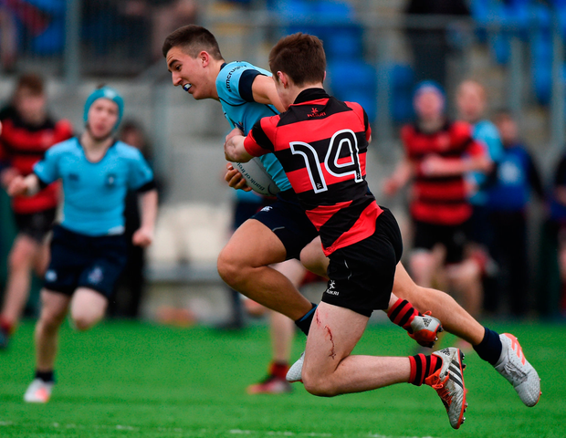 Tim Gilsenan of St. Michael's College is tackled by Adam Strong of Kilkenny College. Photo by Matt Browne/Sportsfile
