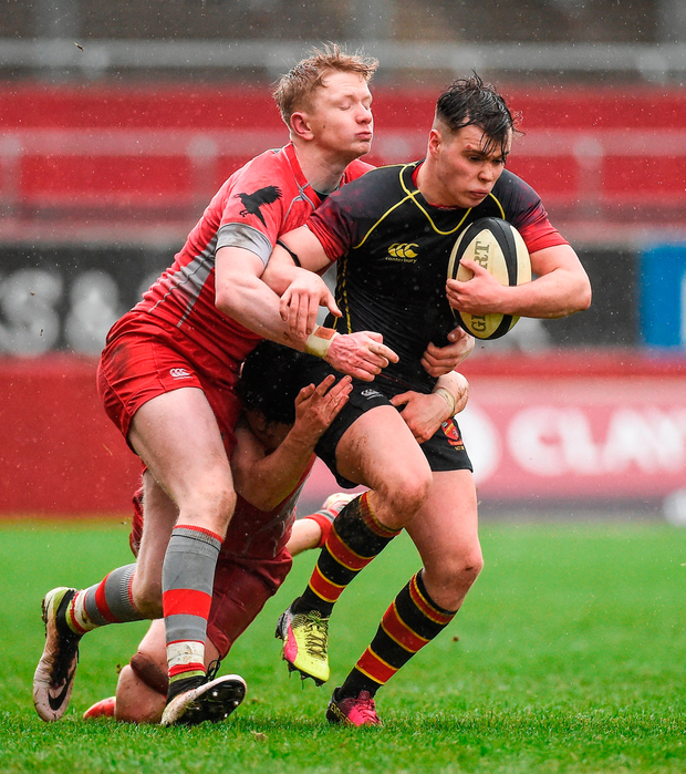 Colin Madden of Ardscoil Rís is tackled by Jamie Mawhinney of Glenstal Abbey. Photo by Diarmuid Greene/Sportsfile