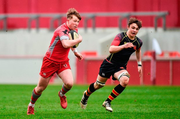 Luke Fitzgerald of Glenstal Abbey is tackled by Sean Hanley of Ardscoil Rís. Photo by Diarmuid Greene/Sportsfile