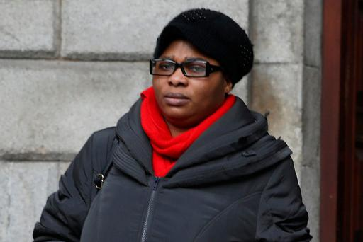 Esther Lamidi leaves court after losing her action for damages. Photo: Collins