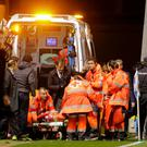 Paramedics take Atletico Madrid's Fernando Torres to a waiting ambulance Picture: Reuters