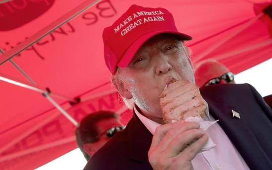 Trump scoffing a pork lolly