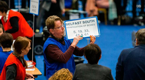 Election count staff count ballot papers at the main Belfast count centre, Titanic Exhibition Centre. Photo: Liam McBurney/PA Wire