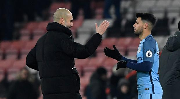 BOURNEMOUTH, ENGLAND - FEBRUARY 13: Pep Guardiola, manager of Manchester City shakes hands with Sergio Aguero of Manchester City after the Premier League match between AFC Bournemouth and Manchester City at Vitality Stadium on February 13, 2017 in Bournemouth, England. (Photo by Stu Forster/Getty Images)