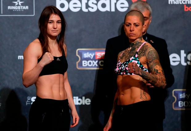 Katie Taylor (left) and Monica Gentili at yesterday's weigh-in ahead of tonight's fight. Photo: John Walton/PA