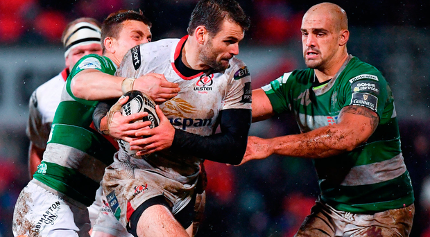 Jared Payne of Ulster is tackled by Tommaso Iannone, left, and Marco Lazzaroni of Benetton Treviso during the Guinness PRO12 Round 17 match. Photo: Ramsey Cardy/Sportsfile