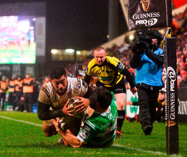 Ulster's Charles Piutau dives over to score his side's third try despite the tackle of Andrea Pratichetti of Benetton Treviso. Photo: Ramsey Cardy/Sportsfile
