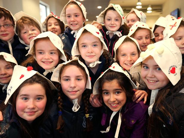 Pupils from Rathgar junior school wear bonnets on their heads for a photo project to remember thousands of women incarcerated at Grangegorman in the 1840s and 50s prior to their transportation to Van Diemen's Land. Photo: Damien Eagers